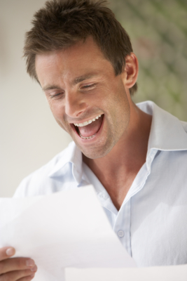 Man reading and smiling