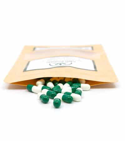 teh-real-cbd-cbd powder-green-capsules-with-open-pouch 450x400