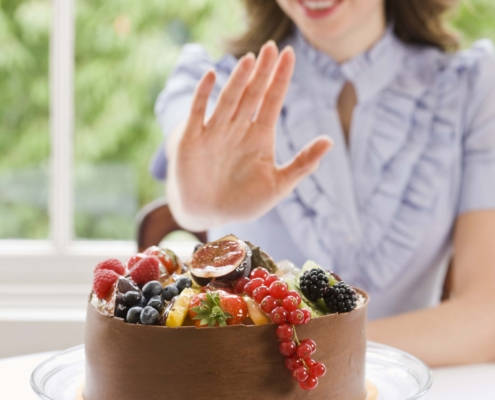 Woman declining chocolate cake thcv Appetite Suppressant