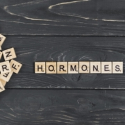 hormones-word-wooden-background